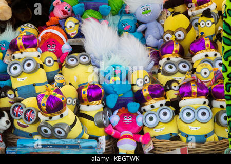 Minions and Trolls toys for sale at an autumn festival. UK - Stock Photo