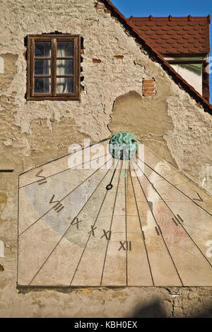 Vintage sun clock on a wall in Zagreb - Stock Photo