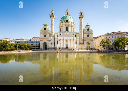 VIENNA, AUSTRIA - AUGUST 29: Tourists at the Baroque Karlskirche in Vienna, Austria on August 29, 2017. The church - Stock Photo