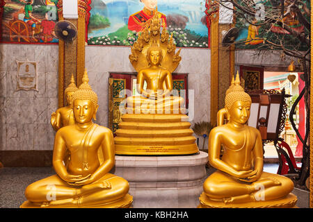 Phuket, Thailand July 4, 2017 : Interior of Wat Chalong temple with many golden statues of Buddha, The Temple is - Stock Photo