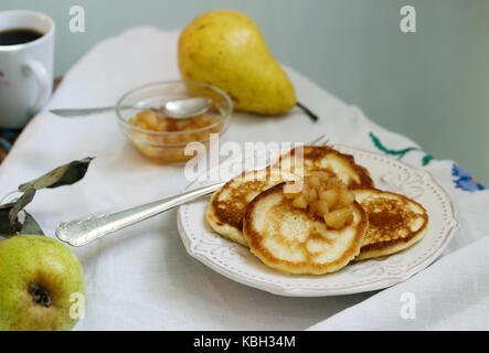 Pancake with pear compote, breakfast. Rustic style, selective focus. - Stock Photo