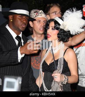 LOS ANGELES, CA - OCTOBER 31: Television personality Kim Kardashian and boyfriend NFL player Reggie Bush attends - Stock Photo