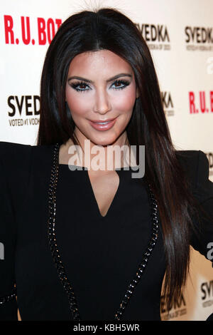 LOS ANGELES, CA - MAY 22: Kim Kardashian and Kourtney Kardashian arrive at the Svedka Vodka's 'R.U. Bot Or Not?' - Stock Photo