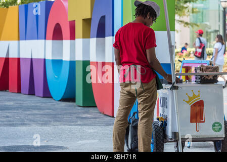 King of Pops popsicle vendor on Peachtree Street in Atlanta, Georgia next to colorful Midtown signage at Colony - Stock Photo