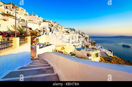 Streets of Fira, Santorini island, Greece. Traditional and famous white houses over the Caldera, Aegean sea. - Stock Photo