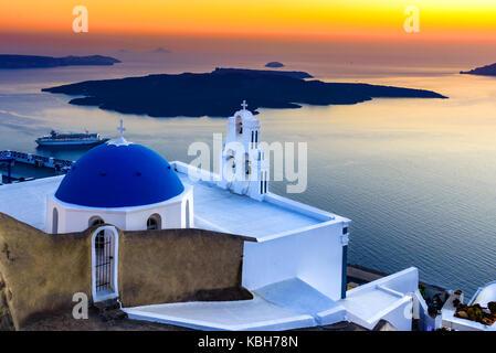 Firostefani, Santorini, Greece. twilight with old greek church and caldera at Aegean Sea - Greek Islands landmark - Stock Photo