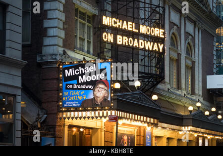 Michael Moore on Broadway in The Terms of My Surrender, a one-man show at the Belasco Theatre in New York City - Stock Photo