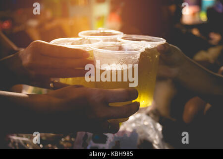 Friends clinking glasses above table.People holding glasses. cheering and celebration concept. - Stock Photo