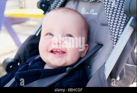 10 month old baby female smiling with new teeth teething UK - Stock Photo
