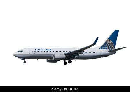 United Airlines 737 jet landing at LAX cut-out - Stock Photo