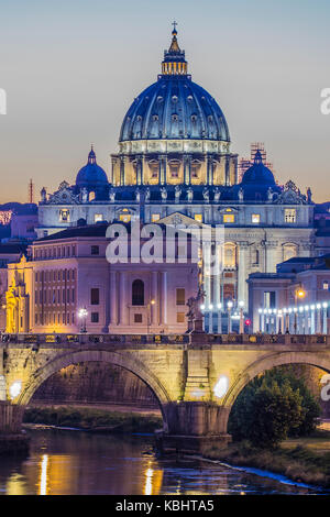 Rome, Italy.Vatican dome of Saint Peter Basilica (San Pietro) and Sant'Angelo Bridge, over Tiber river at dusk. - Stock Photo