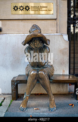 Bronze statue of seated peasant girl by Andràs Lapis outside the Hungarian Institute, Paris France - Stock Photo