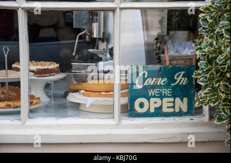 Home made cakes in a shop window, Lymington, Hampshire, UK - Stock Photo