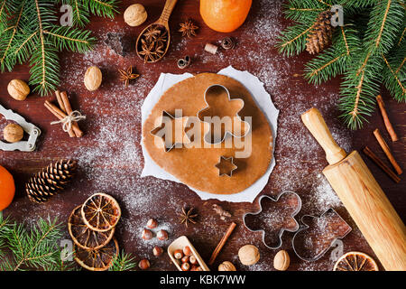 Gingerbread cookies preparation. Christmas cookies baking on wooden background. Christmas decorations, gingerbread - Stock Photo