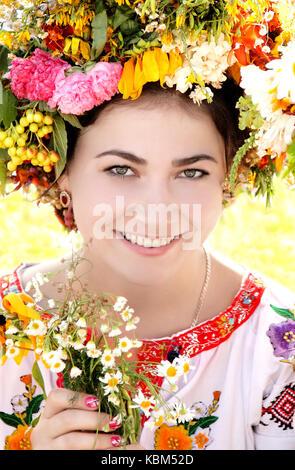 Young girl in Ukrainian traditional national costume, Ivan Kupala Day celebration, Kiev, Pirogovo, Ukraine. - Stock Photo