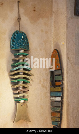 Corsica: wooden and ceramic fishes in one of the souvenir shops in an alley of Bonifacio, city built on the site - Stock Photo