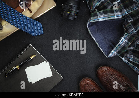 Men Clothing and Accessories shoes, glasses, shirt and name card on dark background. Top view with copy space - Stock Photo