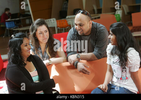 International students socialising together on campus - Stock Photo