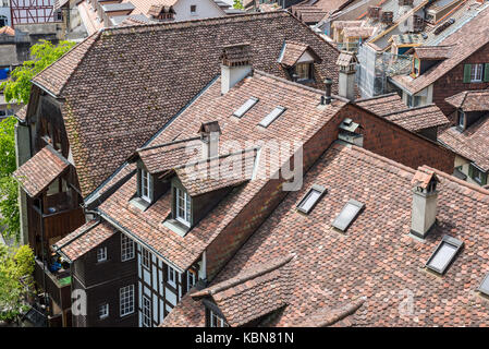 Bern, Switzerland - May 26, 2016: Architecture of the old European town and medieval tiled roof in Bern (Unesco - Stock Photo