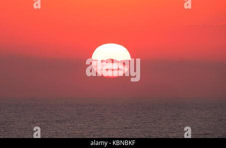 Sunset at Aphrodite's Rock, ( Petra you Romiou) Kouklia, Pafos district, Cyprus - Stock Photo