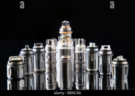 Vaporizers steel coils in a row on a reflective glass - Stock Photo