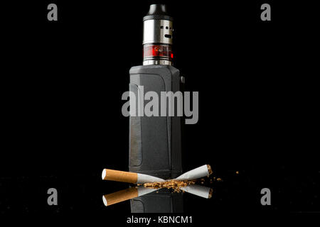 Modern vaporiser versus old tobacco cigarette - Stock Photo