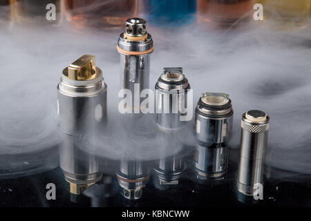 Electronic cigarette Clearomizer coils in smoke cloud - Stock Photo