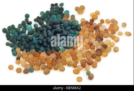 Inactive with active silica gel over white background - Stock Photo