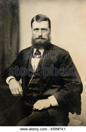 American archive monochrome studio portrait photo on tintype plate of man with a beard wearing a three piece suit - Stock Photo