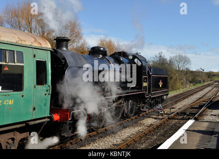 Class U 2-6-0 no. 31806 waits to leave Corfe Castle station on the preserved Swanage Railway in Dorset. - Stock Photo