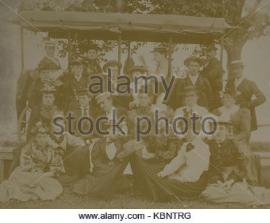 American archive monochrome photo of a group of young people on a picnic at Owasco Lake in a large wagon, dated - Stock Photo