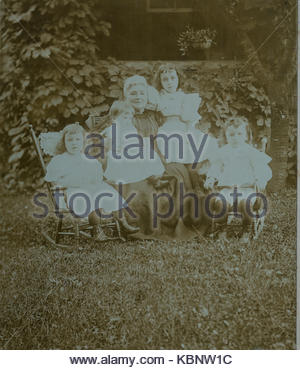 American archive monochrome family portrait photo in a garden with a grandmother and four young grandchildren, two - Stock Photo
