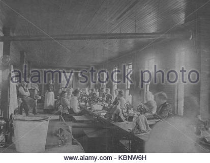 American archive monochrome black and white version of a Cyanotype photograph of employees or workers in the Sewing - Stock Photo
