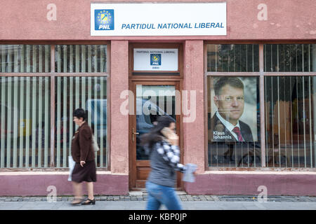 SIBIU, ROMANIA SEPTEMBER 22, 2017: People walking in from of the local office of PNL Party (Partidul National Liberal, - Stock Photo