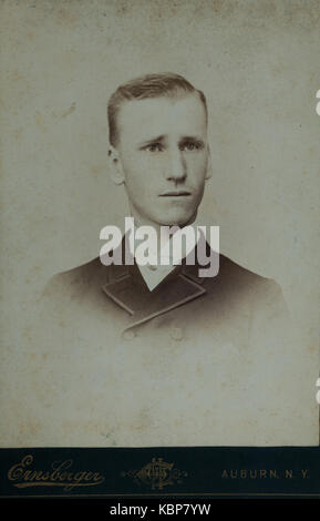 Unedited version of cabinet card photo of an American archive monochrome studio portrait photograph of a young man, - Stock Photo