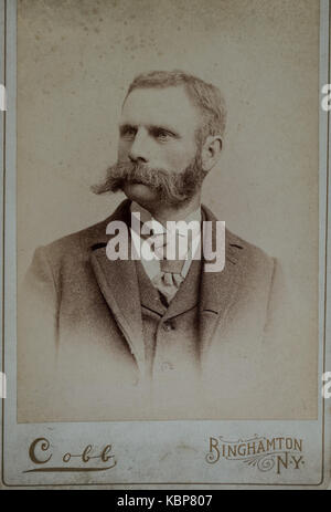 American archive monochrome studio portrait cabinet card photograph of a man with a handlebar moustache and beard - Stock Photo