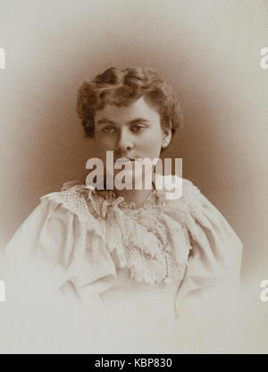 American archive monochrome studio portrait photograph of young woman with thoughtful gaze wearing light coloured - Stock Photo