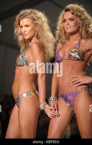 MIAMI BEACH - JULY 19:   Model / TV Personality Cindy Taylor walks the runway at Ed Hardy Swimwear 2009 collection - Stock Photo