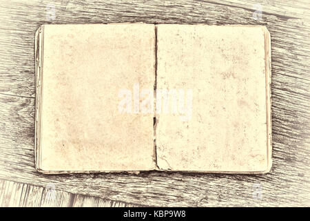 An old book on a wooden table. Country style - Stock Photo