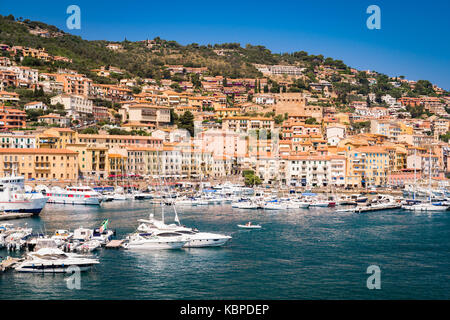 Porto Santo Stefano, Italy - June 24, 2017: Harbor seafront and village skyline, italian travel destination. Monte - Stock Photo