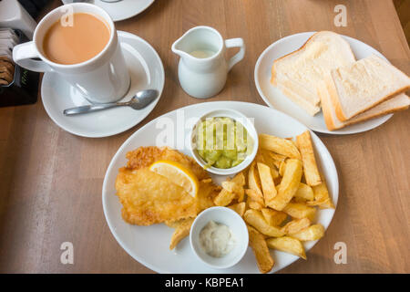 Over sixties Special Fish and Chips a small portion of Cod with mushy peas bread and butter cup of tea traditional - Stock Photo