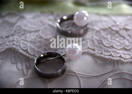 Wedding Rings On A Pillow Fixed With Needles Symbol Of Love At A