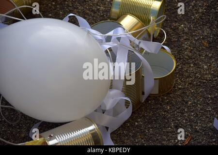 wedding custom or wedding Tradition, balloons and Tins behind a car - Stock Photo