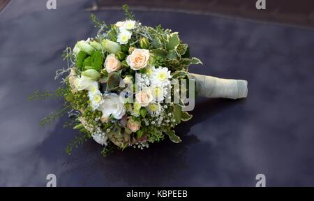 A Bridal Bouquet In Shades Of Apricot White And Creme Stock Photo