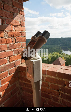 Viewing telescope on the scenic lookout above the beach in ...