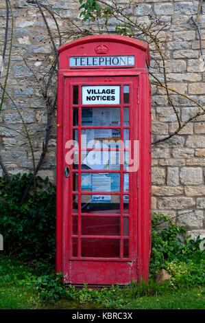 Telephone box used for village notices, Bradden, Northamptonshire, England, UK - Stock Photo