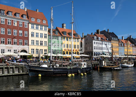Nyhavn - New Harbor - a 17th-century waterfront, canal and entertainment district in Copenhagen, Denmark. - Stock Photo