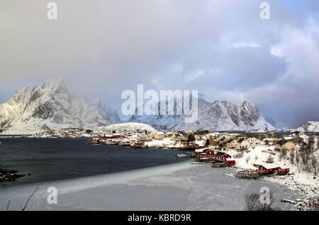 Clean on the Lofoten at noon in a winter's day, Norway., Reine auf den Lofoten mittags an einem Wintertag, Norwegen. - Stock Photo