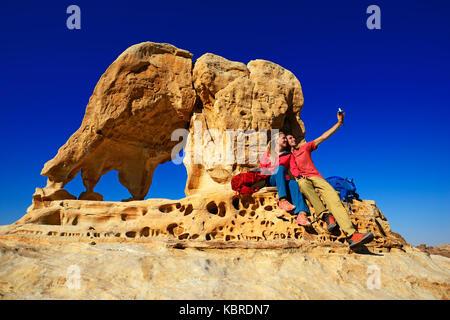Hikers climb Elephant Rock outside of Petra, Wadi Musa, Jordan - Stock Photo