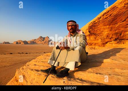 Bedouin looking at Wadi Rum, Jordan - Stock Photo